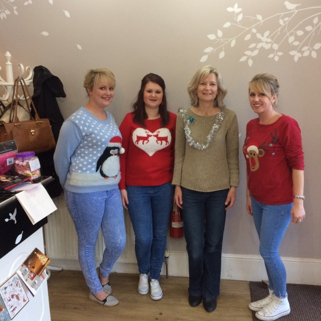 Staff of the Cutting Room with Sarah Spong (Chair Deal Save the Children) supporting Save the Children Jumper Day - left to right - Mary Nutall, Caley Cameron, Sarah Spong and Carina Wood