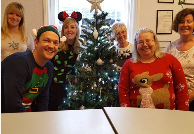The team at Hardmans Solicitors in their festive knitwear.